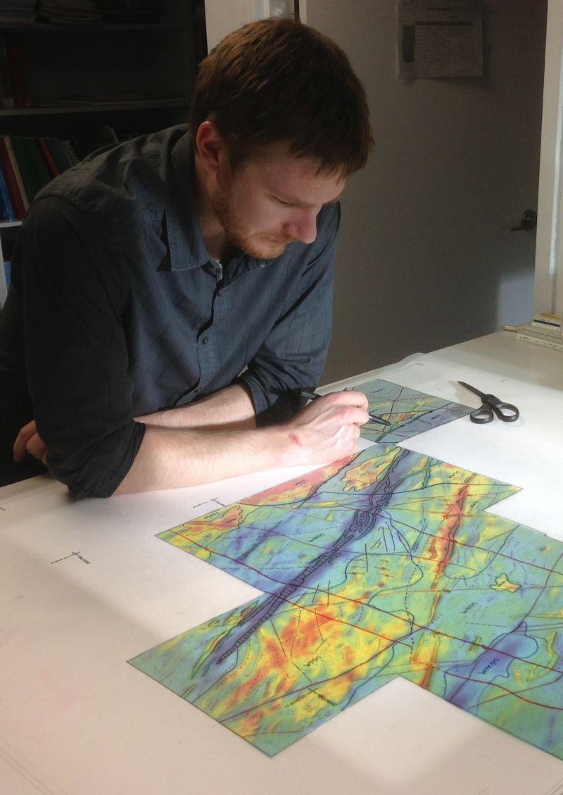 Dave Toni interpreting aeromagnetic data